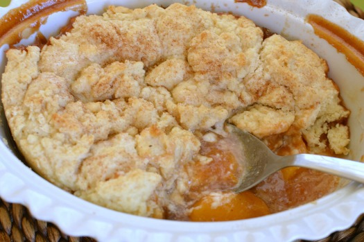 I love serving this peach cobbler for breakfast! Afterall, it's yummy peaches with biscuits and cream!