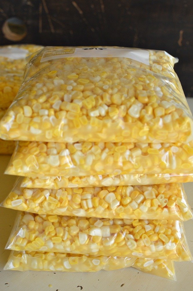 five bags of yellow corn kernels in freezer bags