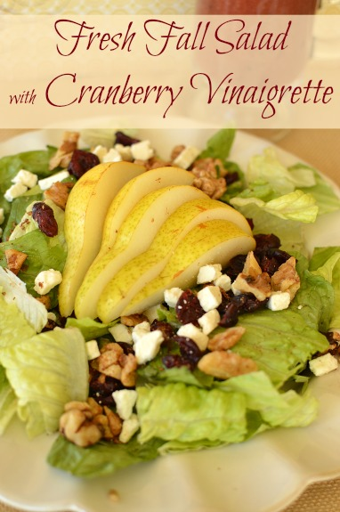 A salad tossed in a cranberry vinaigrette explodes with all the best fall flavors! Cinnamon sugar walnuts are one of my favorite parts! www.littledairyontheprairie.com