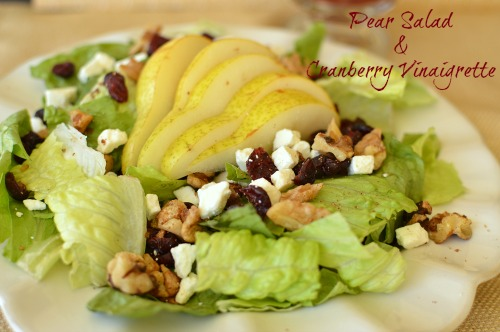Cranberry vinaigrette, cinnamon walnuts and pears are a sure bet in making this salad feel like the fall!