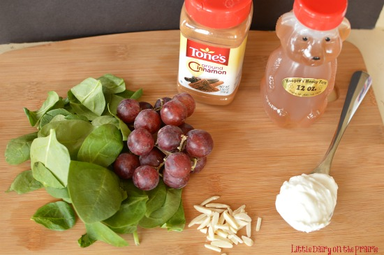 Crunchy almonds, sweet grapes, healthy spinach and cinnamon yogurt dressing! A yummy way to eat a healthy salad! Even my husband loved it!! - Little Dairy on the Prairie