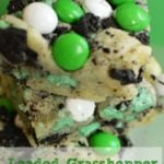 Cookie Bars with sugar cookie crust, topped with crushed oreos and green and white m&Ms