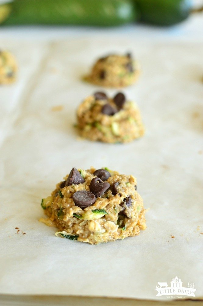 3 raw zucchini Cookies on a cookie sheet