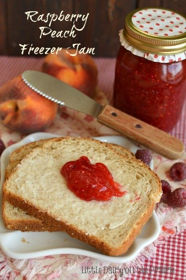 Savor the summer flavors of juicy peaches and fresh raspberries all winter long with Raspberry Peach Freezer Jam! It only takes about and hour to make. Little Dairy on the Prairie