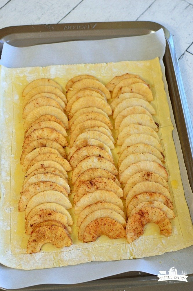 Simple Puff Pastry Apple Tart has sliced apples, tossed in a sugar mixture, placed on top of a puff pastry. It's and easy dessert! www.littledairyontheprairie.com