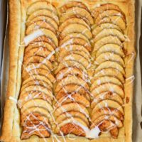 Simple Puff Pastry Apple Tart has sliced apples, tossed in a sugar mixture, placed on top of a puff pastry. It's and easy dessert! www.littledairyontheprairie.com #desserts #baking #dessert #apples #pie #fall #puffpastry #easyrecipe #recipe #yummy
