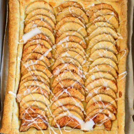 Simple Puff Pastry Apple Tart has sliced apples, tossed in a sugar mixture, placed on top of a puff pastry. It's and easy dessert! pitchforkfoodie.com #desserts #baking #dessert #apples #pie #fall #puffpastry #easyrecipe #recipe #yummy