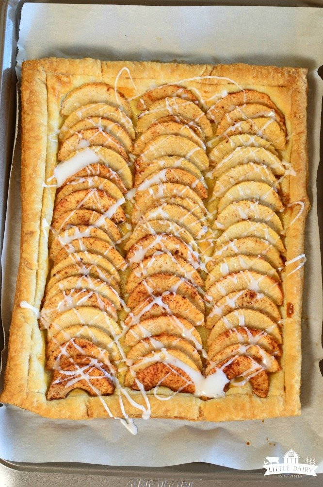 Simple Puff Pastry Apple Tart has sliced apples, tossed in a sugar mixture, placed on top of a puff pastry. It's and easy dessert! pitchforkfoodie.com