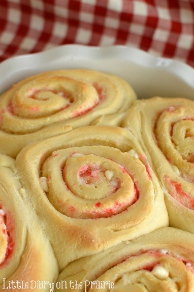 Candy Cane Sweet Rolls! Slather with cream cheese frosting, sprinkle with crushed candy canes! Oh my goodness! Little Dairy on the Prairie