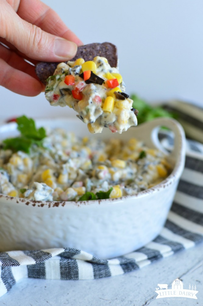 Skinny Poolside Dip- a blue chip with cream dip, corn kernels, chopped red peppers, and cilantro