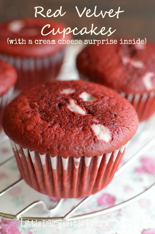 Of course you could frost these Red Velvet Cupcakes. I think they are divine just the way they are...thanks to a cheesecake surprise inside! Little Dairy on the Prairie