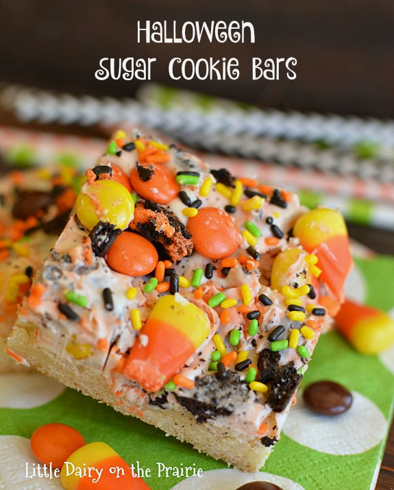 Halloween Sugar Cookies Bars are basically a sugar cookie topped with candy loaded bark! It's the best of both worlds! Little Dairy on the Prairie