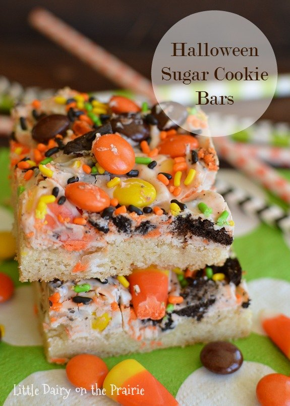 These Halloween Sugar Cookie bars are so much quicker than rolling out sugar cookies, and they are LOADED with Halloween candy! Little Dairy on the Prairie
