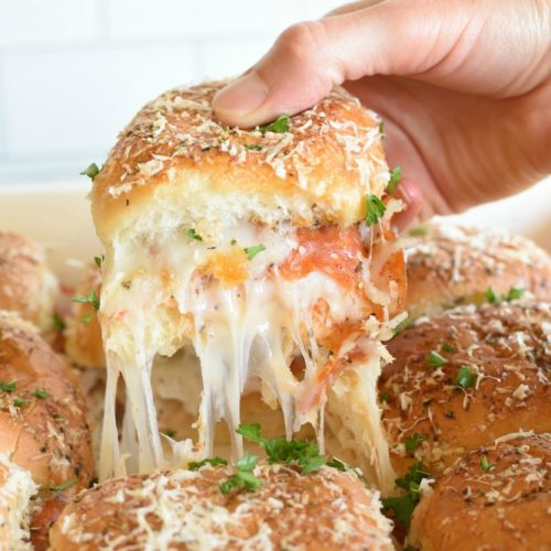 Make Ahead Pepperoni Pizza Sliders are an easy way to make pizza without having to fuss with making crust. They are perfect for packing in lunches. www.littledairyontheprairie.com #pizza #pepperoni #pepperonipizza #makeaheadmeals #freezereals #lunches #quickmeals #onthegomeals #sandwiches #pizzasandwiches #cheese #schoollunches
