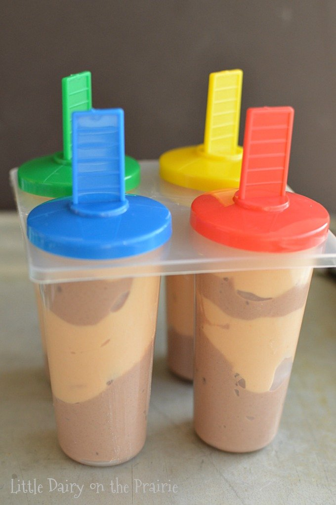 popsicles with layers of peanut butter and chocolate in a Popsicle mold.