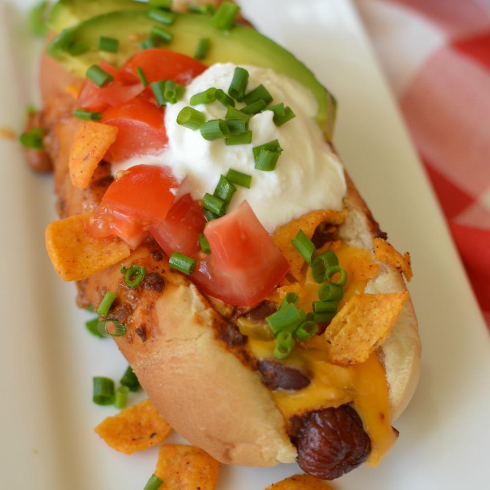 This Loaded Cheesy Chili Dog puts your average chili dog to shame! Ya, it's that good!