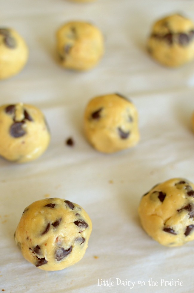 coconut chocolate chip cookie dough balls on a baking sheet