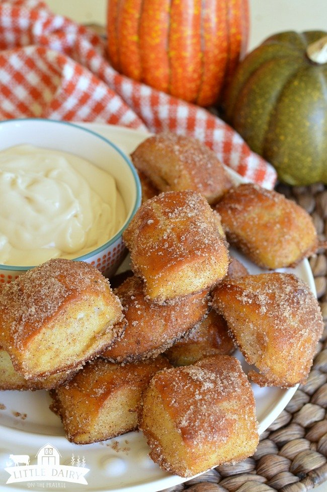 pretzel bites on a platter with white dipping sauce in a bowl
