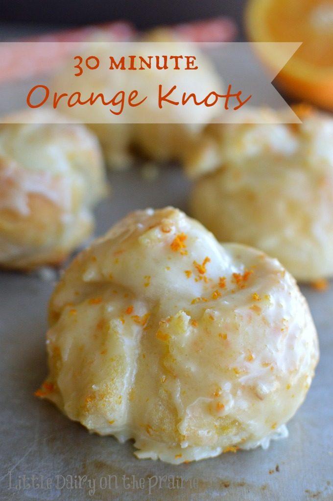 Baked orange knots on a baking sheet
