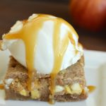 A blondie with vanilla ice cream and caramel sauce.
