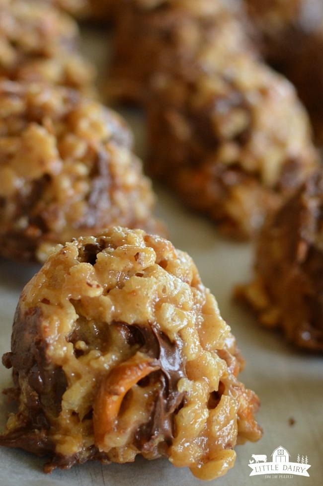 cookie balls on a baking sheet