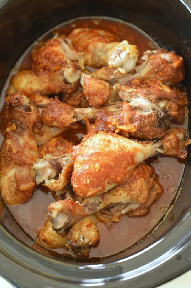 cooked chicken legs in a slow cooker