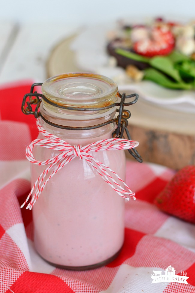 pink strawberry salad dressing in a jar