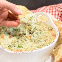 cream cheese dip with broccoli on a piece of croustini