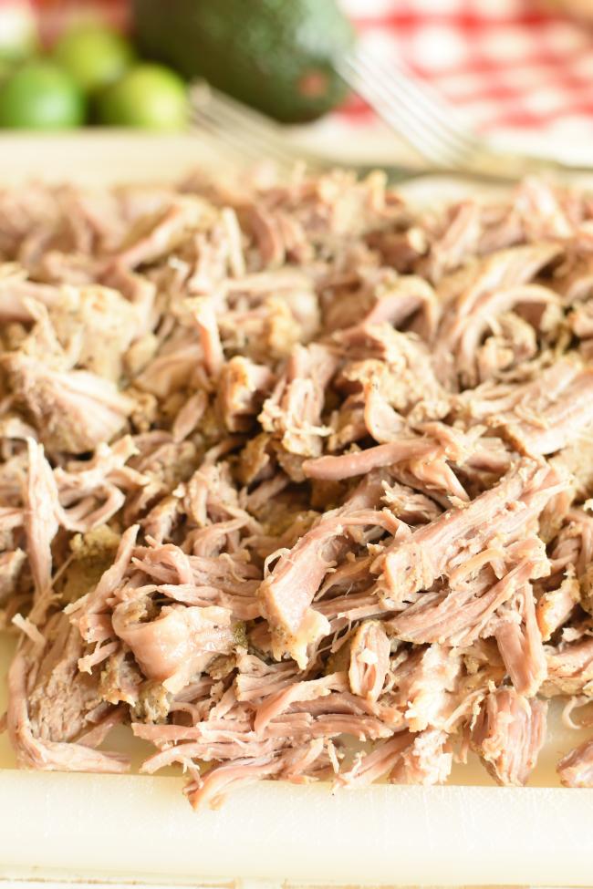shredded pork on a cutting board