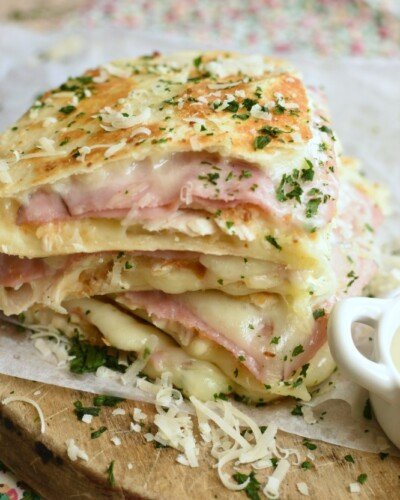 wedges of golden brown quesadillas with deli ham, diced chicken, and melted swiss cheese