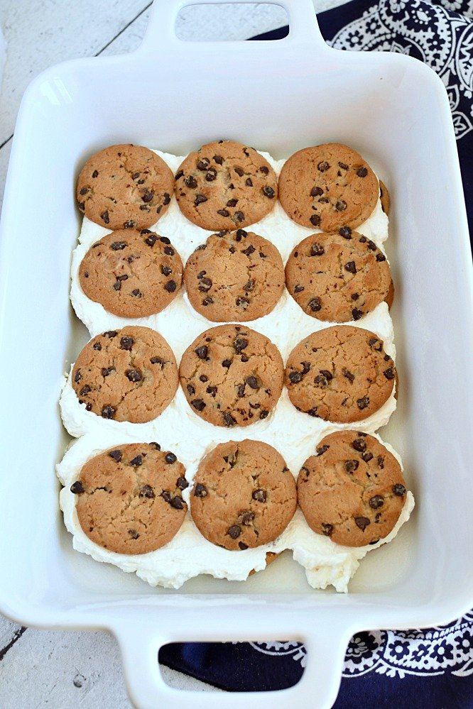 12 chocolate chip cookies set on top of a layer of whipped topping