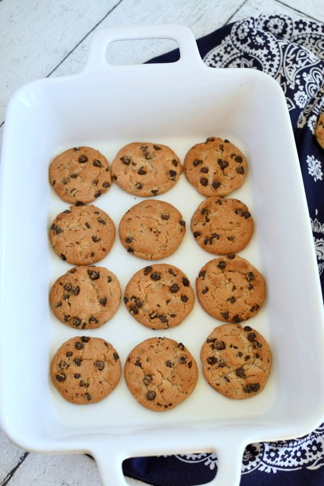 12 chocolate chip cookies in a white baking dish