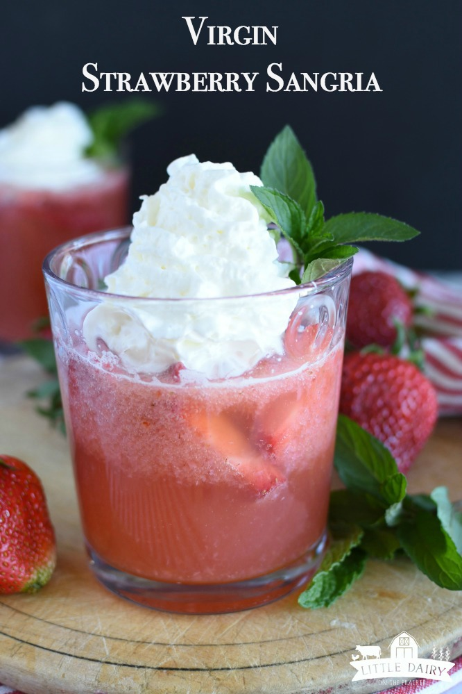 Virgin Strawberry Sangria with Whipped Cream is an easy makeahead drink the whole family can enjoy! Whipped cream makes it exta delicious! www.littledairyontheprairie.com #drinks #mocktail #nonalcohol #strawberries #whippedcream #dirtydrinks #easyrecipe #beverages #summerdrinks
