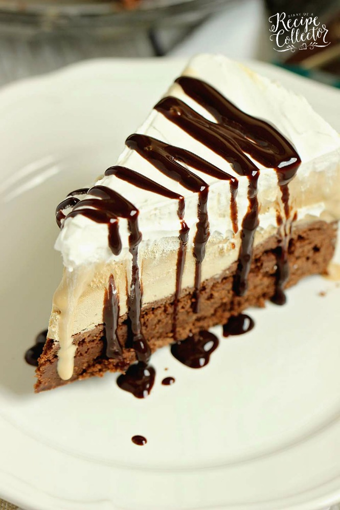 A wedge of ice cream pie with chocolate drizzled on top