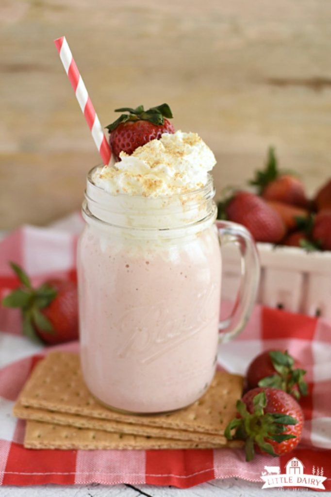 Fresh ingredients to make a strawberry cheesecake smoothie