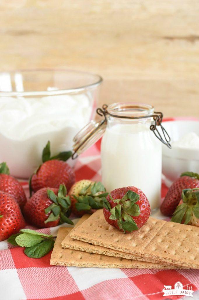 Fresh strawberries, graham crackes, milk, and vanilla Greek yogurt