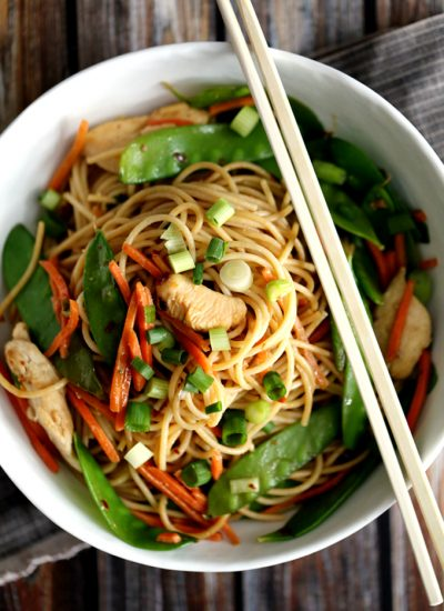 Chinese noodles, snap peas, with chopsticks