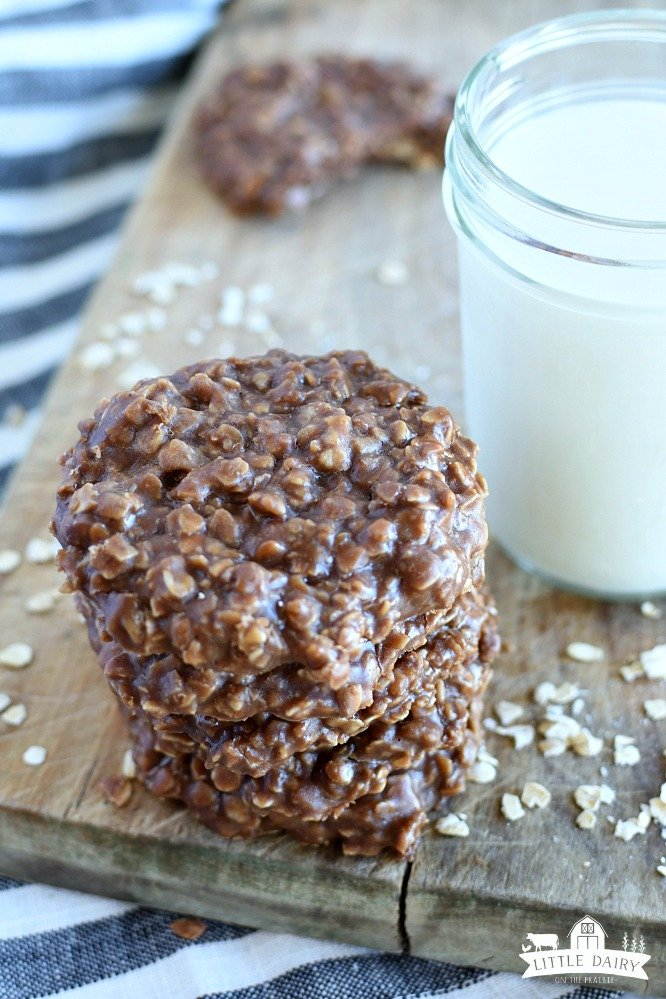 a stack of no bake cookies, a jar of milk