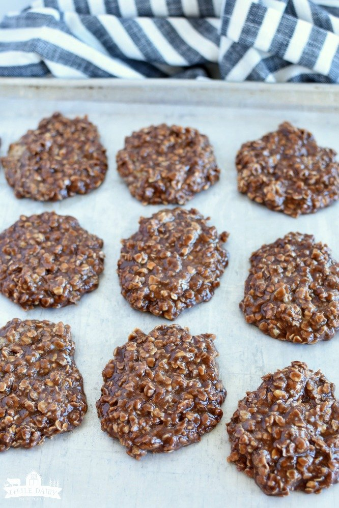 a cookie sheet with no bake chocolate oatmeal cookies dropped on it