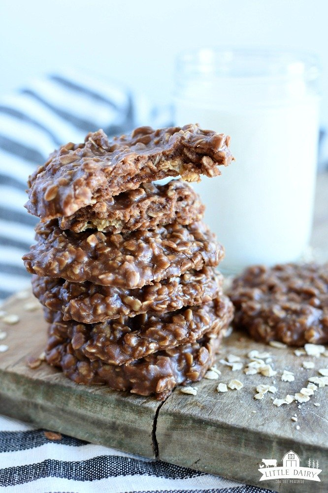 Classic No Bake Cookies- a stack of no bake cookies, a jar of milk, the top cookie has a bite taken out of it