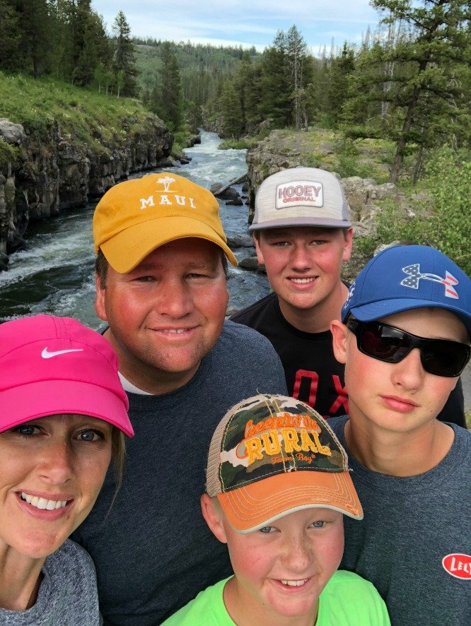 4 boys and 1 girl in front of a mountain stream