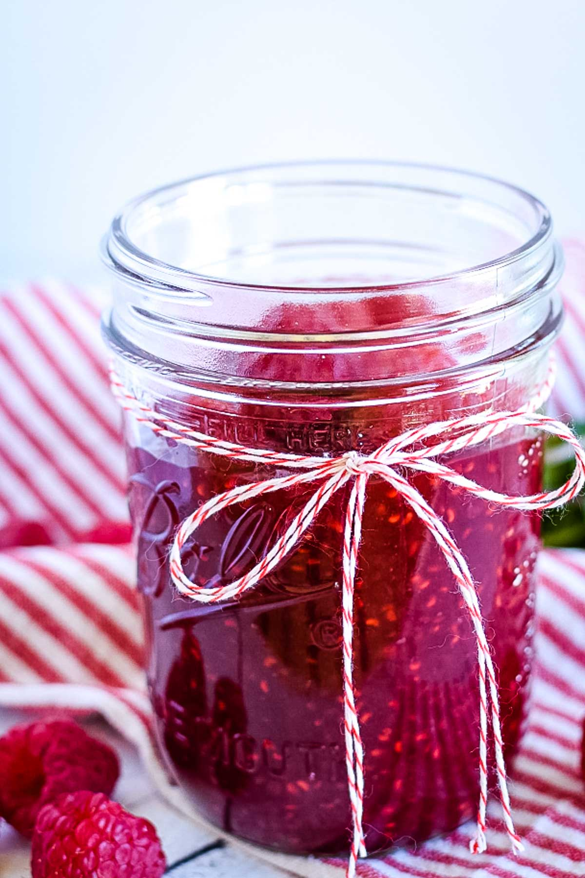 A jar of raspberry dessert topping.