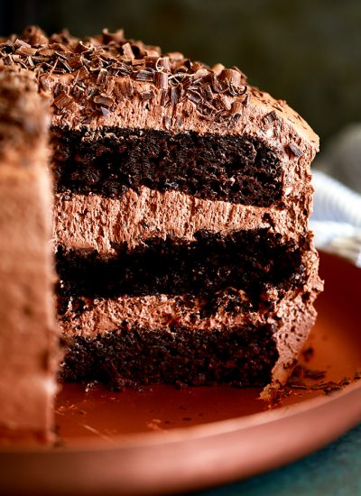 triple layer chocolate cake on a platter