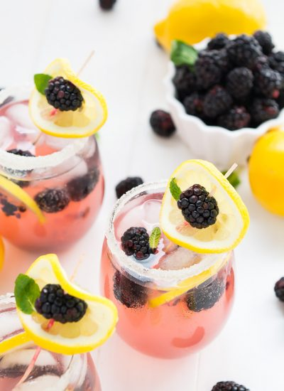 Lemonade in glasses with blackberries and lemon slices on top