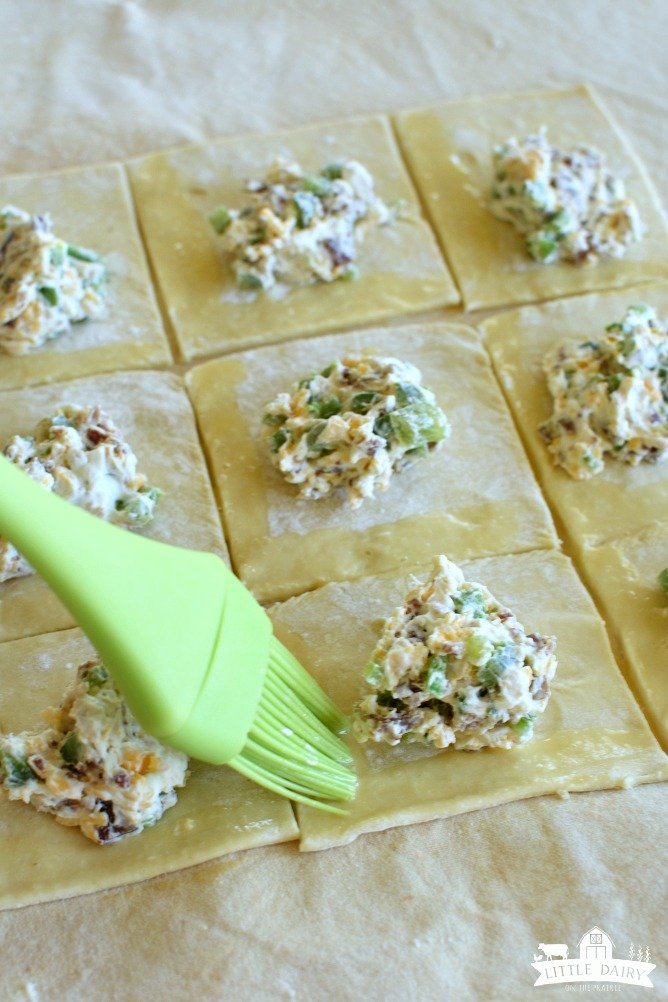 Brush edges of puff pastry with an egg wash to help the seems stay together.