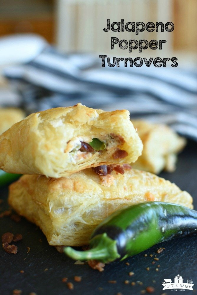 Mini Jalapeno Popper Turnovers have the classic flavors of crispy bacon, shredded cheese, spicy jalapenos, and cream cheese all wrapped up in a tender and flaky puff pastry turnover! They're a portable appetizer that's perfect for game days, or any party! www.littledairyontheprairie.com #jalapenos #appetizers #cheese #fingerfood #tailgate #bacon #puffpastry