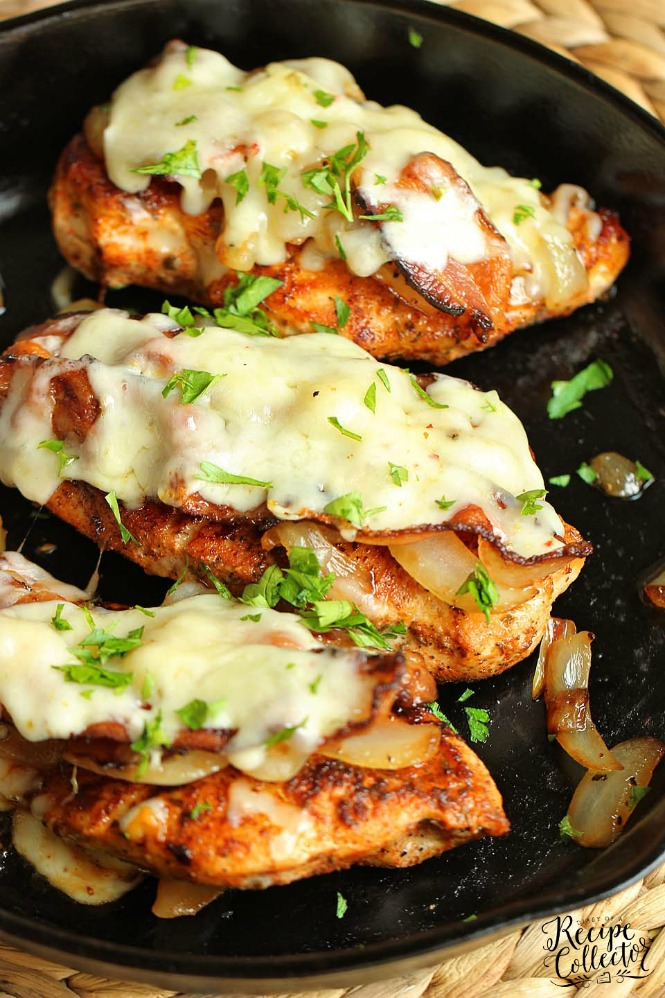 a black pan with pepperjack cheese melted on blackened chicken breasts