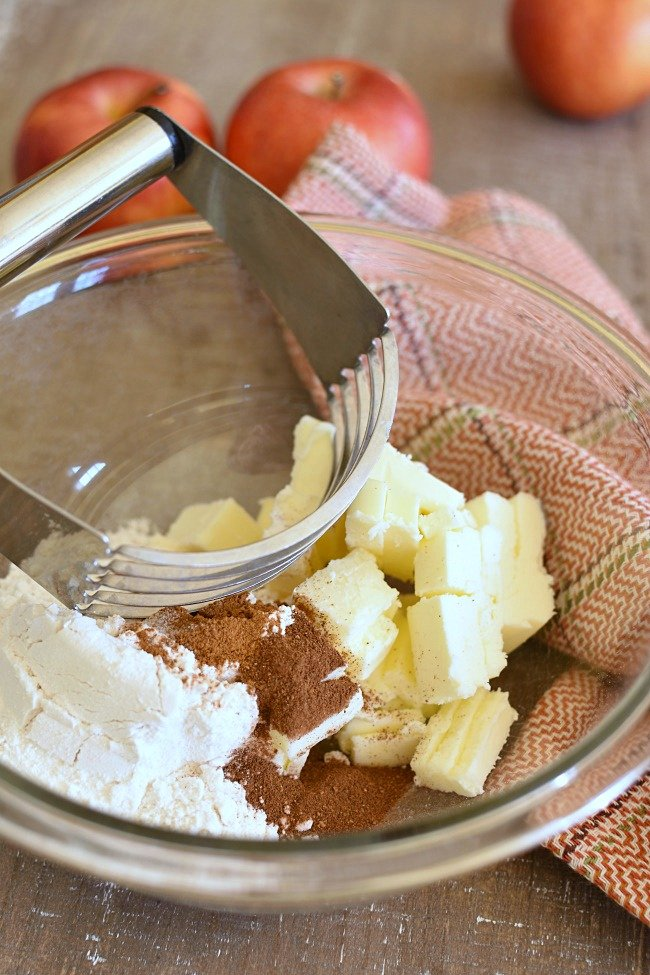 A bowl with butter, apple pie spices, and flour