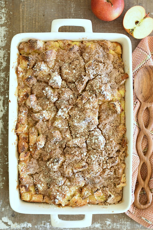 A white pan with baked apple pie french toast
