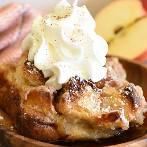 Apple Pie French Toast Casserole on a plate with whipped cream